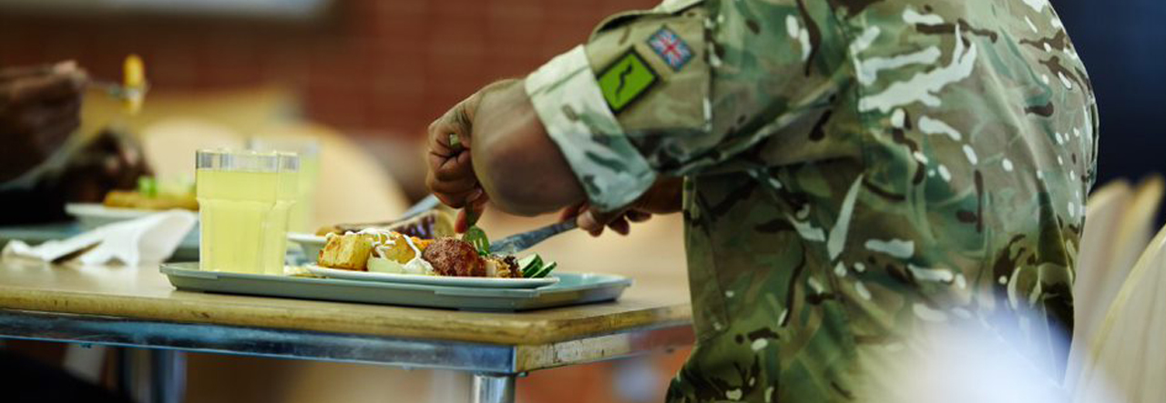 man sat eating catering on defence site