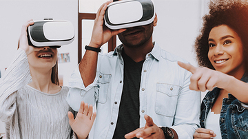 Woman pointing at people wearing VR glasses