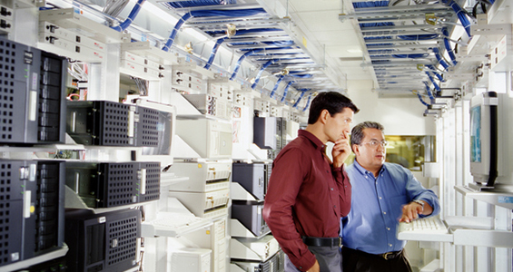 Two men in an IT server room