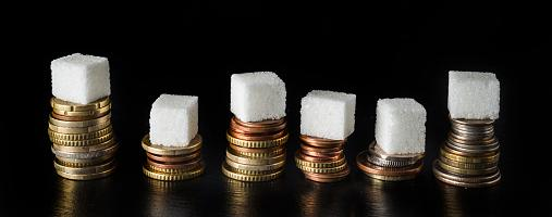 Sugar tax - Image of sugar lumps on coins